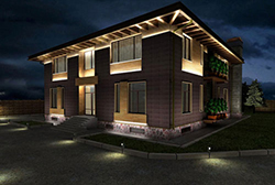 Профессиональное выполнение архитектурно-художественного освещения придаёт загородному дому солидность