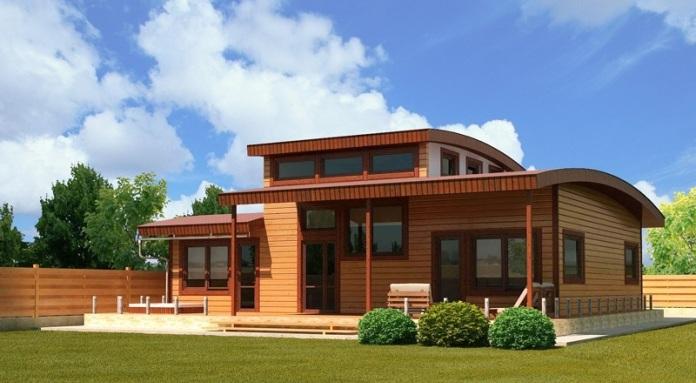 Деревянные дома выглядят привлекательнее, если покраска выполняется глянцевыми составами