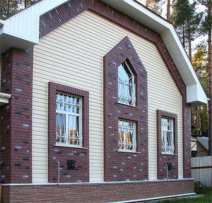 Фасадными панелями можно придать любой стиль вашему дому