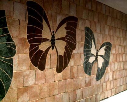 Творческая комбинация различных отделочных материалов сделает ваш фасад оригинальным