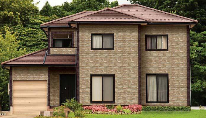 Отделка каркасного дома цокольными сайдинговыми панелями «под камень» способна придать строению очень привлекательный внешни й вид